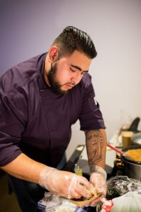 Chef Pedro Ortiz plating up his food.